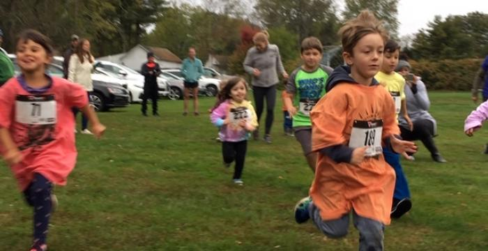 Photo of children and families at the 1k Kids Fun Run.
